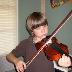 Student learning the fiddle.