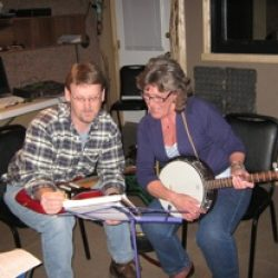 Dean teaching Banjo.